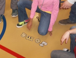 "Our children unscramble the word ""Jambo,"" meaning ""Hello!"""