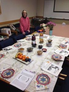 Janet Tatz, Jewish Educator, with the table set for a festive TuB'Shevat celebration on campus