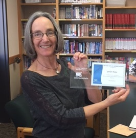 Janet receives a certificate in recognition of her efforts in establishing a strong Jewish Education program over the last 10 years