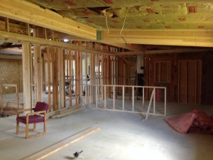 "view looking north in café/study lounge area (half-framed wall depicts where the ""soda counter"" will be)"